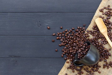 coffee bean and cup on black wooden background. top view