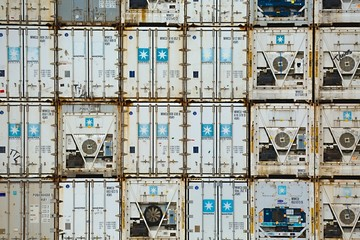 ROTTERDAM, THE NETHERLANDS - SEPTEMBER 22, 2015: Maersk containers stacked in a shipping terminal. Maersk is the largest container ship operator in the world since 1996.