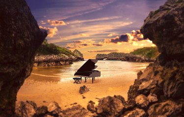 Piano in nature.Surreal image related to piano music,song and melody.Beach and ocean in cliffs scenic landscape