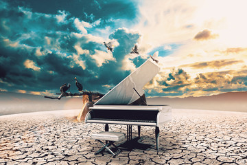 Piano in nature.Surreal image related to piano music,song and melody.Sunset and dry soil scenic landscape.Birds and cracked floor