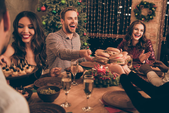 Attractive lovely smart stylish cheerful cheery glad positive friendly guys having fun sitting sharing meal snack festal mood great occasion celebratory night in house indoors