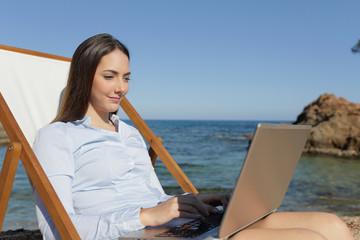 Serious entrepreneur using laptop on the beach