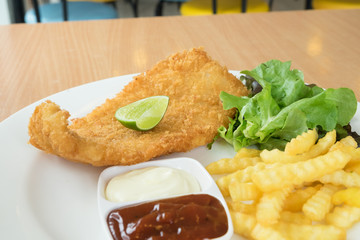fried fish and chips with sauce