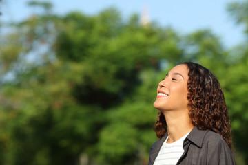 Happy mixed race woman breathing fresh air Wall mural