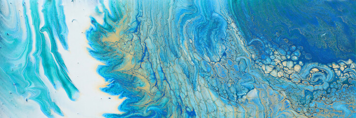 art photography of abstract marbleized effect background. turquoise, blue and gold creative colors. Beautiful paint. banner