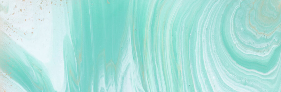 photography of abstract marbleized effect background. turquoise, gold, blue and white creative colors. Beautiful paint. banner
