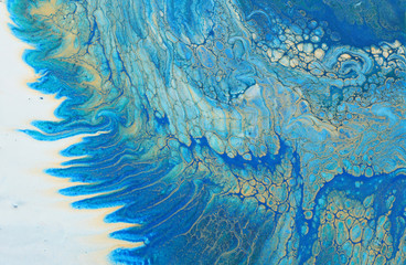 art photography of abstract marbleized effect background. turquoise, blue and gold creative colors. Beautiful paint.