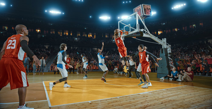 Basketball players on big professional arena during the game. Tense moment of the game. Celebration