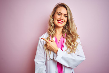 Young beautiful doctor woman using stethoscope over pink isolated background cheerful with a smile...