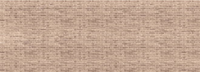 Panoramic background of wide beige brick wall texture. Home or office design backdrop