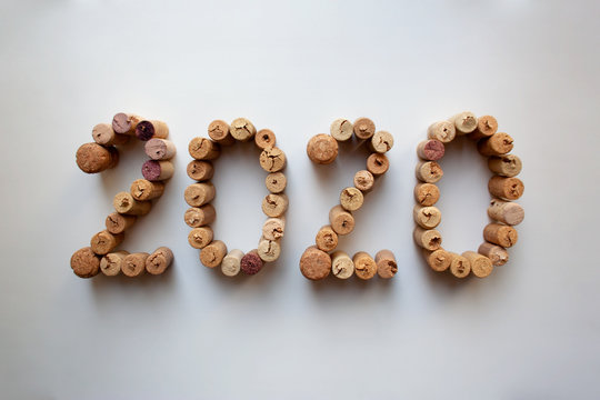 Wine corks 2020 New Year composition isolated on white background