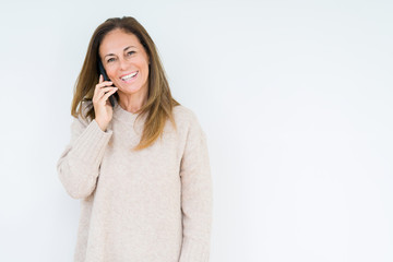 Wall Mural - Middle age woman talking on smartphone over isolated background with a happy face standing and smiling with a confident smile showing teeth
