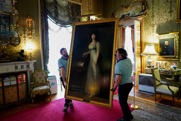 "Workers carry ""The Marquise of Lazan"" painting by the Spanish painter Francisco Goya at Liria Palace in Madrid"