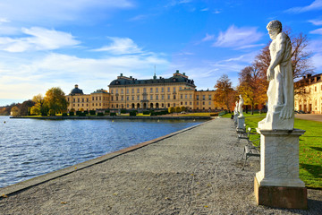 Drottningholm Palace, Sweden's royal residence along its statue lined lake during autumn