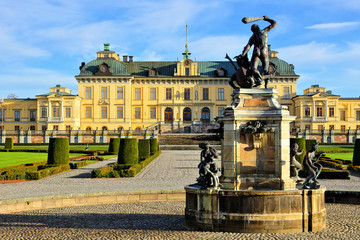 Drottningholm Palace with fountain in its picturesque gardens, Stockholm, Sweden
