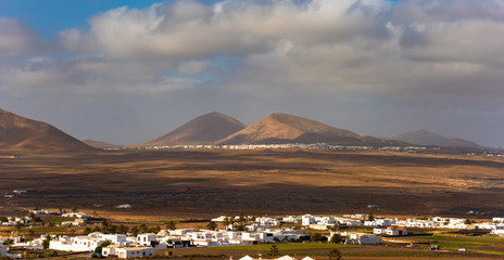 Typical Canarian village or town with white houses and volcanic landscape, Nazaret, Lanzarote island, Canary, Spain