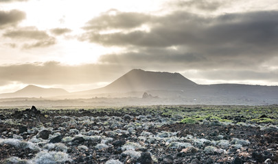 beautiful mountain landscape with volcanoes at sunset in Timanfaya National Park in Lanzarote, Canary Islands