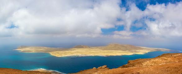 Scenery of volcanic Lanzarote - panoramic view from Mirador del Rio for island Graciosa. Canary islands