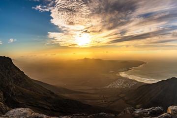 Amazing summer sunset over ocean resort beach Famara Lanzarote Canary Islands, Spain