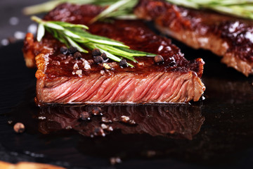Barbecue Rib Eye Steak or rump steak - Dry Aged Wagyu Entrecote Steak on rustic background