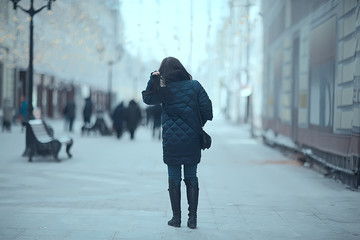 girl in a coat in the winter city / concept of fatigue stress christmas chores