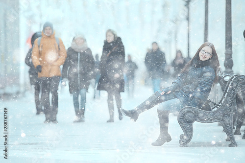 Model In Christmas Vacation.Adult Model Girl In A Coat On A Winter Walk In The City