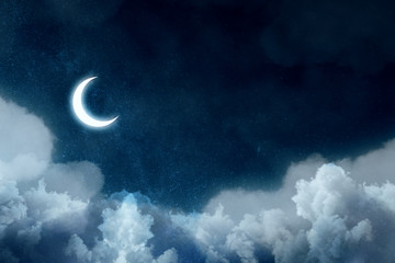Night picture with bright moon above clouds at starry sky.