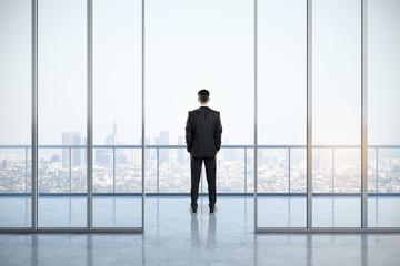 Businessman in contemporary office interior