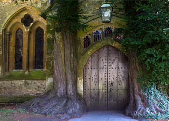 St Edward - Parish Church north door flanked by yew trees - Cotswolds - England, United Kingdom