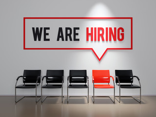 We are hiring text on office wall