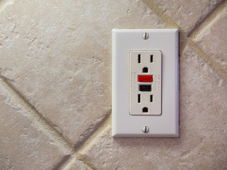 Ground fault interrupter electricity receptacle and wall plate. Residential electric socket plug with GFI reset button.