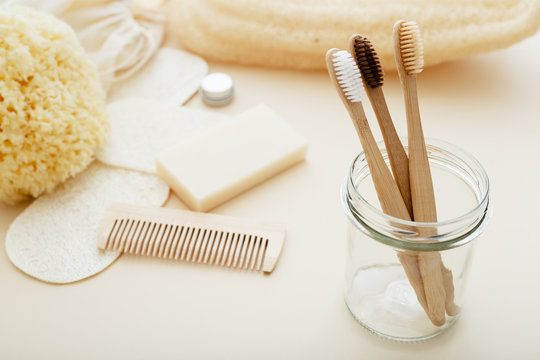 Zero waste and plastic free concept with bamboo tooth brush, towel, sea sponge, loofah, soap, wooden hair brush. Eco-friendly bathroom. Natural products.