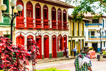 View on colorful red colonial buildings at central square of village Jerico in Colombia