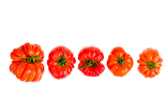 Red fresh beefsteak tomatoes on white background.