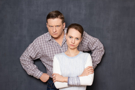 Portrait of serious and dissatisfied caucasian man and woman