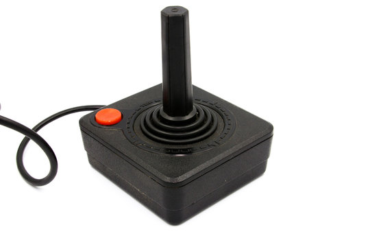 A studio shot of a Atari Controller isolated on a white background.