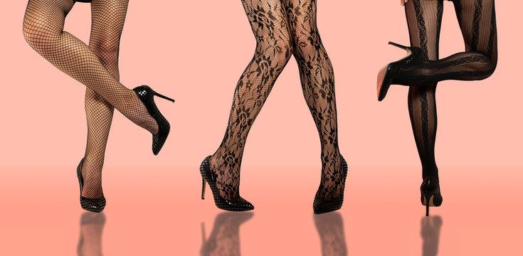 Three girls in stocking / pantyhose making fashion poses , just legs