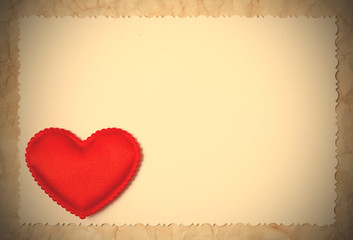 Red hearts on a blank photo paper