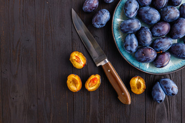 harvest fresh ripe plum in a saucepan on the table. cooking organic dessert