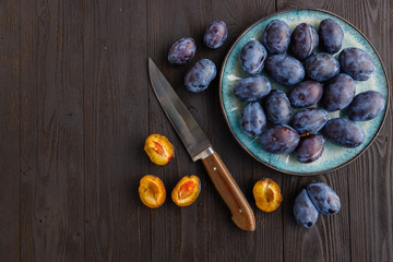 fresh ripe Plums in dish on table