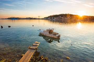 Foto auf Acrylglas Beige boot moored at the wooden pier in harbour of Losinj town, Croatia.
