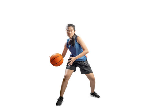 Asian woman basketball player in action with the ball