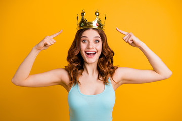 Photo of foxy lady indicating finger on big golden headwear wear tank-top isolated yellow background