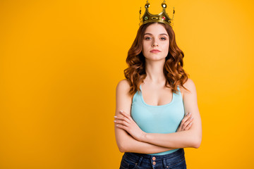Photo of foxy lady crossing arms wear tank-top and big golden crown isolated yellow background