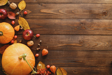 Creative Top view flat lay autumn composition. Frame border made of pumpkins, dried fall leaves,...
