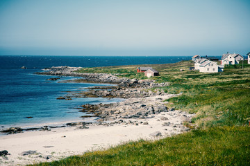 Fototapete - Lofoten islands in Norway, beautiful landscape, white sand beach and traditional beach houses