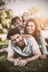 Portrait of happy family playing in park
