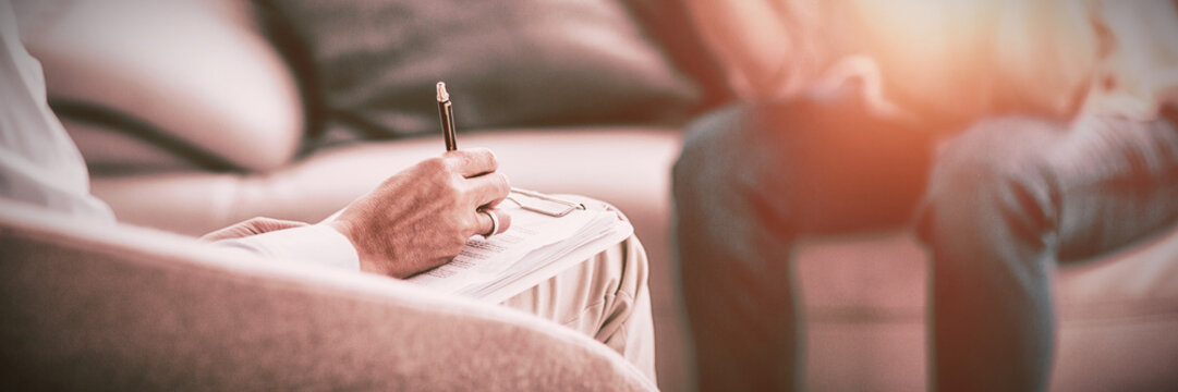 Therapist making notes of patient