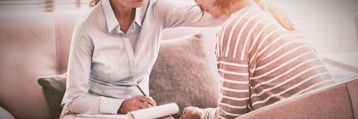 Therapist comforting woman