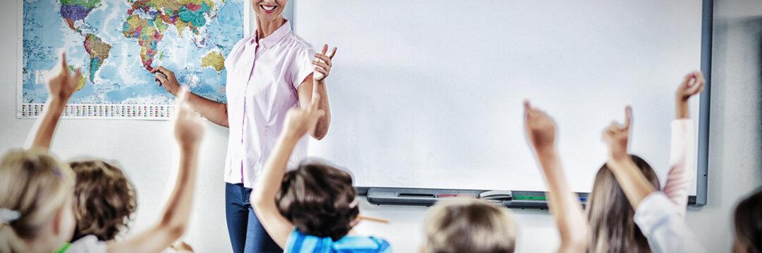 Teacher teaching kids in classroom